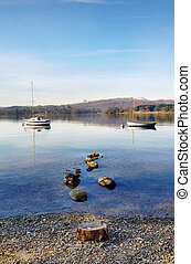 Two boats moored on Lake Windermere - Peaceful view of two...