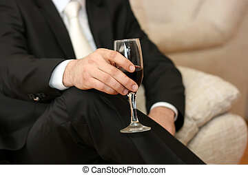 Toasting - Glass of wine in his hand a businessman