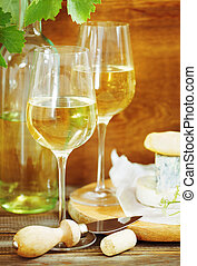 Still life with glasses of white wine and chesse - Still...