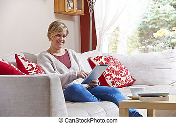 Mother on tablet computer
