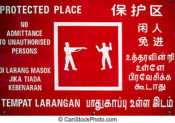 Warning sign - Multilanguage warning sign at Singapore...