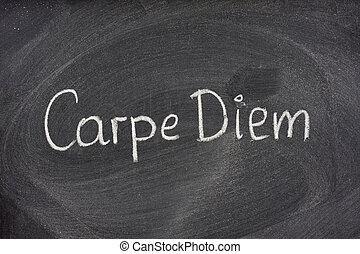 Carpe Diem phrase on blackboard - Enjoy life before its too...