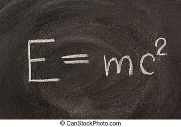 Albert Einstein E=mc2 physical formula on blackboard -...