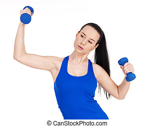 Focus woman exercising with dumbbell