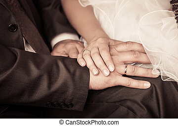 bride and groom to hold hands loving care retro photo