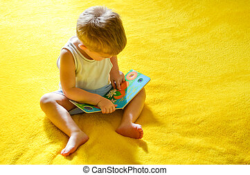 little funny boy reading book - Small child funny boy...