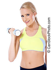 Close up of blond happy woman with dumbbell in her hand over...