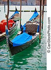 Gondolas in Venice canal - gondolas anchored near square San...