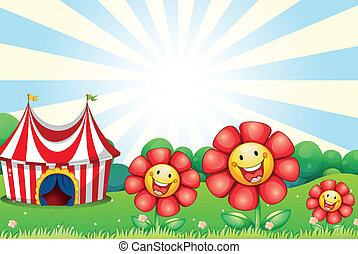 Three plastic flowers and a tent at the top of the hill -...