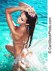 water pleasure - attractive young woman refresh in pool...