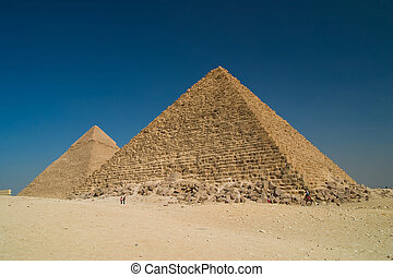 Pyramids in Giza - Great Pyramid of Khufu on right, and the...