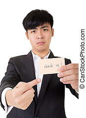 check it - Asian businessman holding a card written on check...