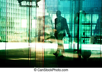 silhouettes in the business district - silhouettes of man...
