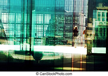 silhouettes in the business district - two women visiting...