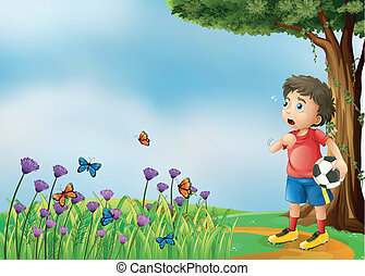 A boy with a soccer ball at the hill - Illustration of a boy...