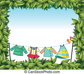 A frame border with hanging clothes and a bird