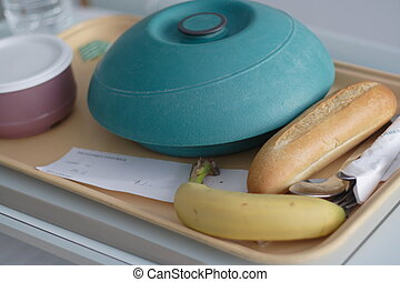hospital diner tray with main course bread and banana