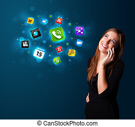 Young woman calling by phone with various icons - Attractive...