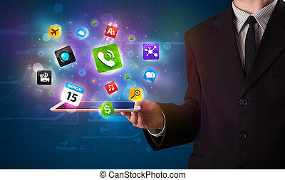 Young businessman holding a tablet with modern colorful apps...