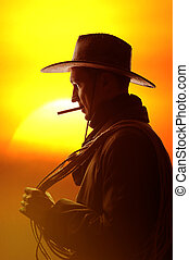 cowboy in hat silhouette - cowboy in hat with cigar and...