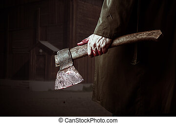 Axe with blood in male hand. murderer or butcher, halloween...