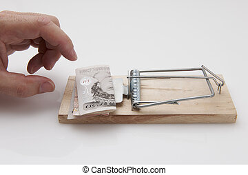 Hand grabbing money - Male hand taking fifty pound note from...