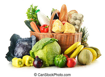 Wicker basket with variety of grocery products isolated on...