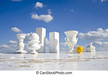 still-life with white vases and yellow billiards ball