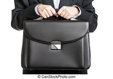 Businessman hand holding briefcase - Business man in black...