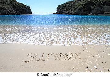 ?Summer? written on sandy beach