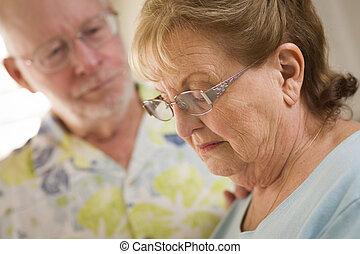 Senior Adult Male Consoles Sad Senior Adult Female - Senior...