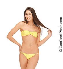 beautiful woman in bikini playing with hair - picture of...