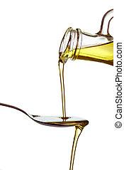 olive oil condiment vegeterian food - close up of olive oil...