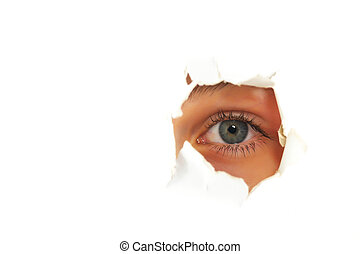 Girl looking through a hole in paper