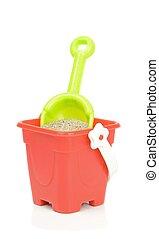 A Toy Bucket and Spade - A toy bucket and spade with sand on...