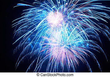 Colorful fireworks - Blue colorful fireworks on the black...