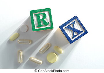 Pills, capsules and Rx on white background