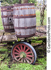 Old Wagon - Old rotting wagon wheel with wooden barrels
