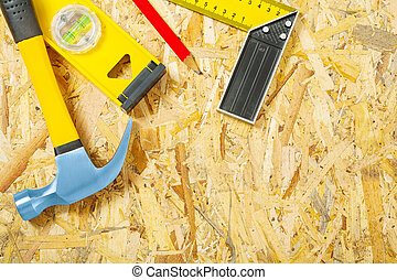 construction tools on plywood
