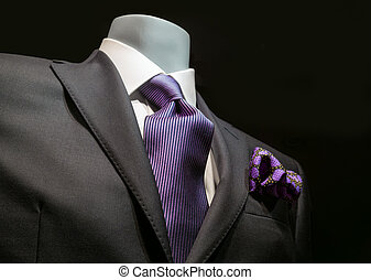 Dark Gray Jacket with Purple Tie - Close-up of a dark gray...