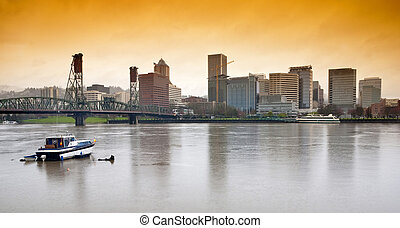 Rainy day on the Willamette river with the Portland skyline...