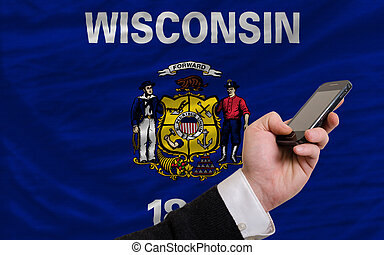 cell phone in front flag of american state of wisconsin -...