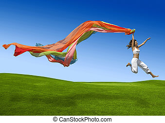 Rainbow woman - Athletic woman jumping on a green meadow