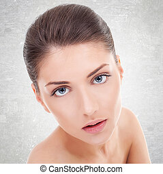 young woman's face with healthy clean skin - Close-up...