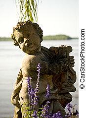Cherub Statues - Cherub statue on the banks of False River...