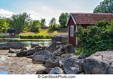 Swedish coastal landscape - Red wooden buildings and granite...