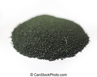 Spirulina powder - Close up of a heap of spirulina powder...