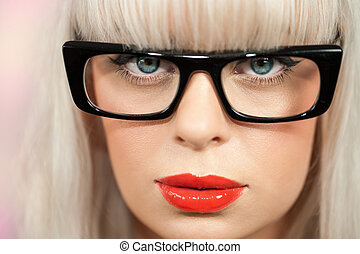 Ectreme close up of woman with black glasses.