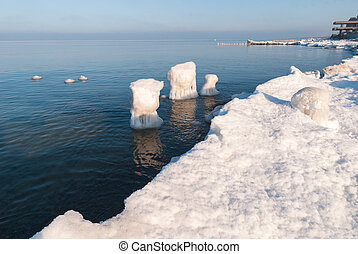 Ice-covered breakwater. Baltic sea. Kaliningrad region....