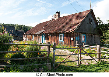 Old wooden house in village. Kaliningrad region. Russia